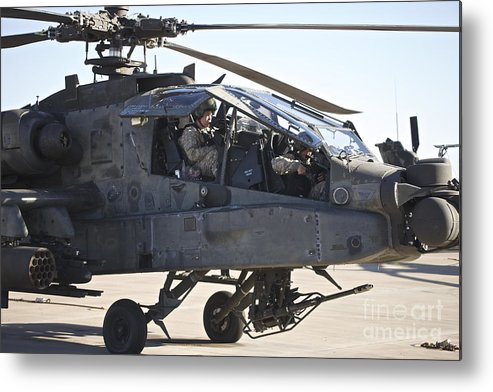 Exercise Angel Thunder Metal Print featuring the photograph Ah-64d Apache Longbow Pilot Prepares by Terry Moore