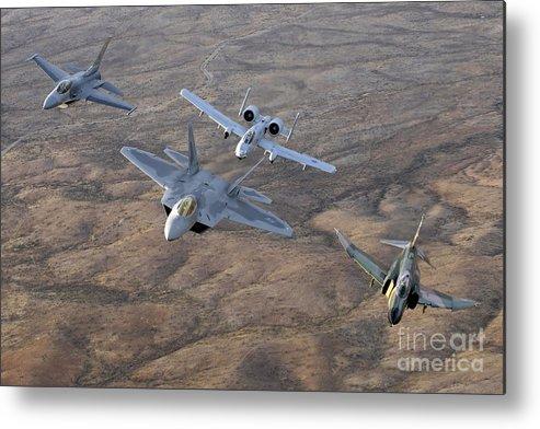 Horizontal Metal Print featuring the photograph An F-22a Raptor, An F-4 Phantom, An by Stocktrek Images