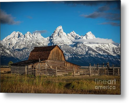 John Moulton Barn Metal Print featuring the photograph Barn And Snow Capped Tetons by Clicking With Nature