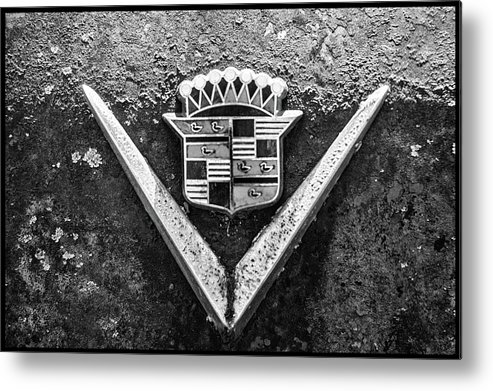 Rusted Metal Print featuring the photograph Cadillac Emblem by Matthew Pace