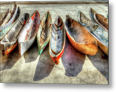The Metal Print featuring the photograph Canoes by Debra and Dave Vanderlaan