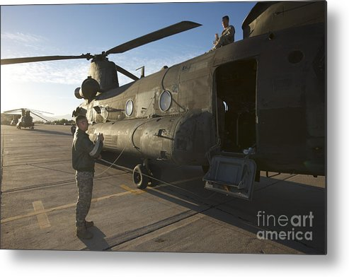 Exercise Angel Thunder Metal Print featuring the photograph Ch-47 Chinook Crew Preparing To Load by Terry Moore