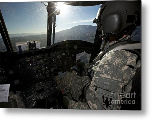 Exercise Angel Thunder Metal Print featuring the photograph Co-pilot Flying A Ch-47 Chinook by Terry Moore
