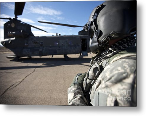 Exercise Angel Thunder Metal Print featuring the photograph Crew Chief Of A Ch-47 Chinook Stands by Terry Moore