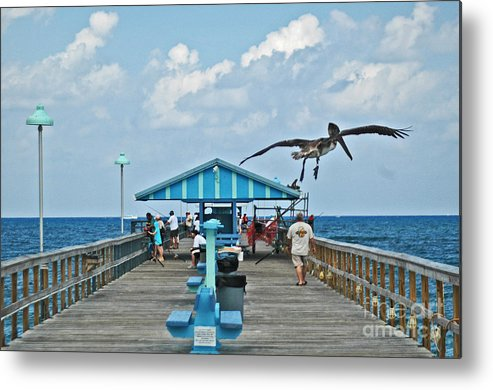 Fishing Pier Metal Print featuring the photograph Fishing Pier With Flying Pelican by Allan Einhorn