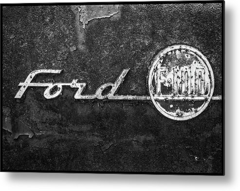 Ford F-100 Emblem Metal Print featuring the photograph Ford F-100 Emblem On A Rusted Hood by Matthew Pace