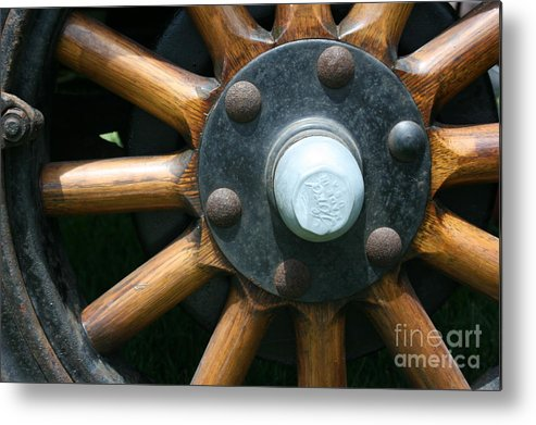 Wagon Metal Print featuring the photograph Ford Wagon Wheel by Dawn Downour
