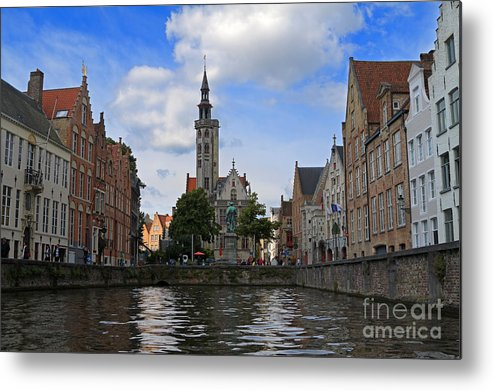 Poortersloge Metal Print featuring the photograph Jan Van Eyck Square With The Poortersloge From The Canal In Bruges by Louise Heusinkveld