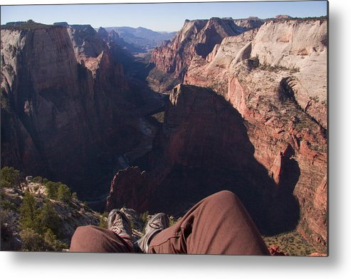 Utah Metal Print featuring the photograph Legs Dangle Over The Cliff Looking by Taylor S. Kennedy