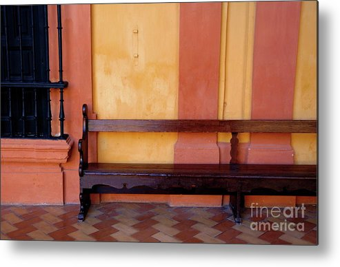 Alcazar Of Seville Metal Print featuring the photograph Long Wooden Bench Against A Yellow Wall At The Alcazar Of Seville by Sami Sarkis