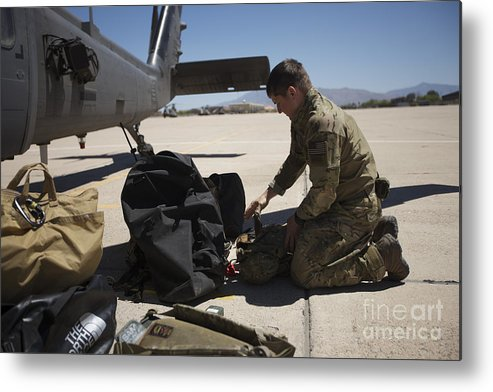 Exercise Angel Thunder Metal Print featuring the photograph Pararescuemen Sorts Out His Gear by Terry Moore