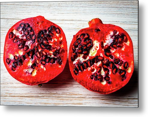 Pomegranate Metal Print featuring the photograph Pomegranate Cut In Half by Garry Gay