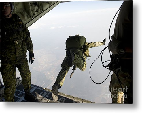 Soldier Metal Print featuring the photograph Special Operations Jumpers Exit A C-130 by Stocktrek Images