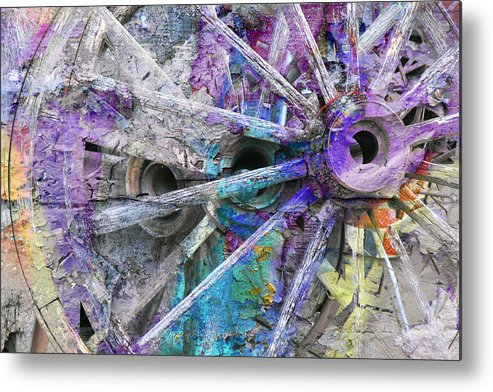 Wagon Wheels Metal Print featuring the photograph Spokin by Ed Hall