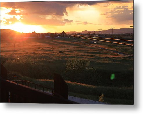Sunset Metal Print featuring the photograph Sunset On The Railroad Track by Remegio Onia