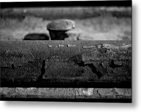 Black And White Photograph Metal Print featuring the photograph Tracks And Bolts by Mike Oistad