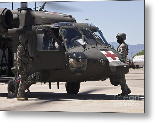 Exercise Angel Thunder Metal Print featuring the photograph Uh-60 Black Hawk Refuels by Terry Moore