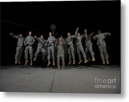 Us Army Metal Print featuring the photograph U.s. Army Pilots & Crew Chiefs Jump by Terry Moore