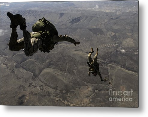 Air Force Metal Print featuring the photograph U.s. Army Soldiers Conduct A Halo Jump by Stocktrek Images