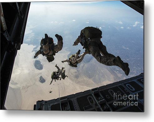 Marine Expeditionary Unit Metal Print featuring the photograph U.s. Pararescuemen And U.s. Marines by Stocktrek Images