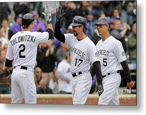 Scoring Metal Print featuring the photograph Los Angeles Dodgers V Colorado Rockies by Doug Pensinger