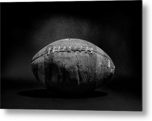 Antique Metal Print featuring the photograph Game Ball - Black And White by Peter Tellone