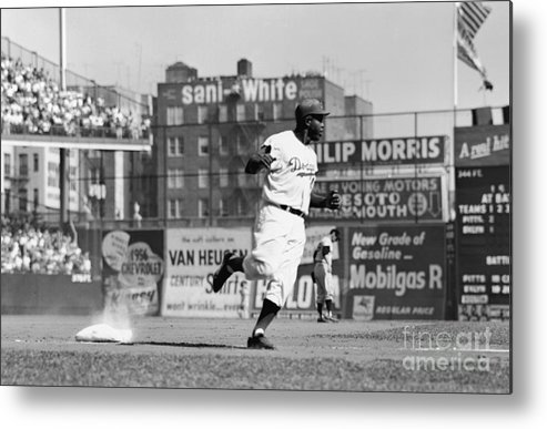 1950-1959 Metal Print featuring the photograph Jackie Robinson Rounds The Bases by Robert Riger