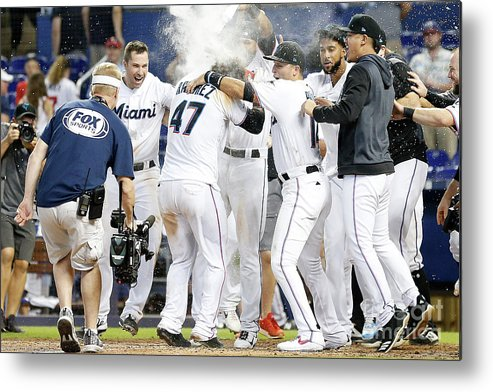 American League Baseball Metal Print featuring the photograph Minnesota Twins V Miami Marlins by Michael Reaves