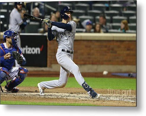 American League Baseball Metal Print featuring the photograph Christian Yelich by Mike Stobe
