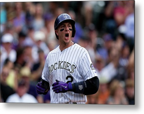 Scoring Metal Print featuring the photograph Carlos Gonzalez And Troy Tulowitzki by Justin Edmonds