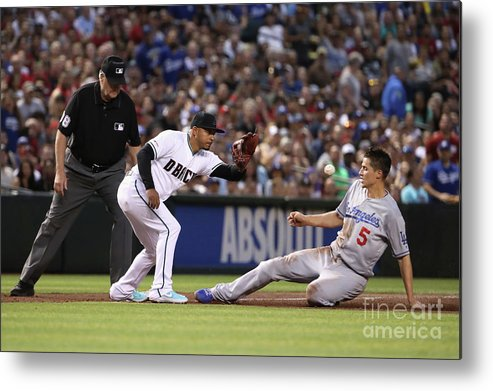 People Metal Print featuring the photograph Corey Seager And Eduardo Escobar by Christian Petersen