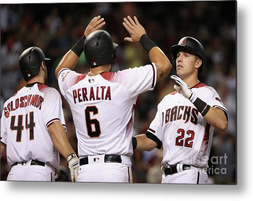 People Metal Print featuring the photograph David Peralta, Paul Goldschmidt, And Jake Lamb by Christian Petersen