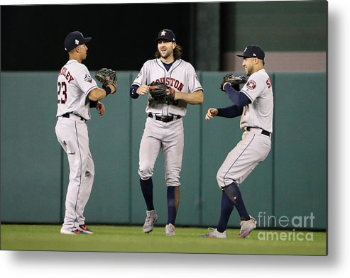 American League Baseball Metal Print featuring the photograph Jake Marisnick, Michael Brantley, And George Springer by Patrick Smith