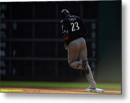 Following Metal Print featuring the photograph Nelson Cruz by Stacy Revere