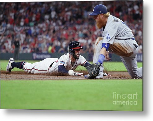 Atlanta Metal Print featuring the photograph Nick Markakis And Justin Turner by Rob Carr