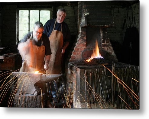 Blacksmith Metal Print featuring the photograph Blacksmith by Stephen Norris