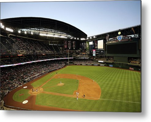 Motion Metal Print featuring the photograph Colorado Rockies V Arizona Diamondbacks by Christian Petersen