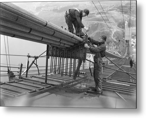 1930s Metal Print featuring the photograph Golden Gate Bridge Work by Underwood Archives
