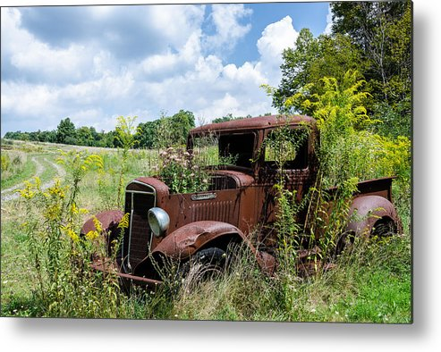 Rusty Truck Metal Print featuring the photograph Recycled Planter by Georgette Grossman