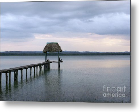 Guatemala Metal Print featuring the photograph Relaxing On The Pier Lake Peten Itza Guatemala by John Mitchell