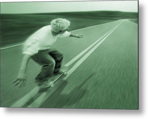 Balanced Metal Print featuring the photograph Teenager Skateboarding Down Road by Don Hammond