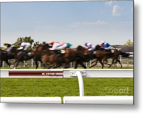 Running Rails Metal Print featuring the photograph The Blur Of Racehorses Racing By The Rails On A Race Track by Peter Noyce