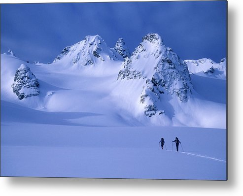 Adventure Metal Print featuring the photograph Two Skiers Ski Tour And Explore by Jimmy Chin