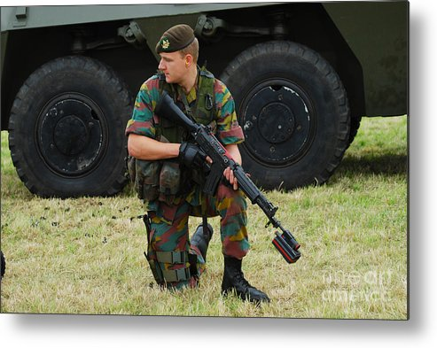 5.56mm Metal Print featuring the photograph A Soldier Of An Infantry Unit by Luc De Jaeger