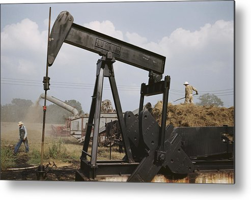 oil Industry And Production Metal Print featuring the photograph Harvestors Trash Fields While Black by B. Anthony Stewart