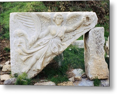 Stone Carving Metal Print featuring the photograph Stone Carving Of Nike by Mark Greenberg