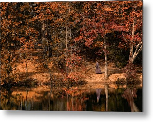 Poeple. Water. Autumn Metal Print featuring the photograph The Walk Home 2 by Robin-Lee Vieira