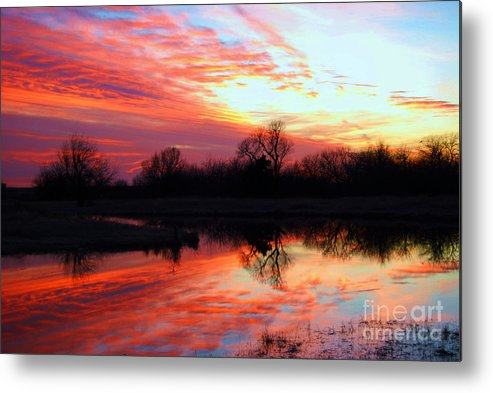 Clouds Metal Print featuring the photograph Calming Sunset by Larry Keahey