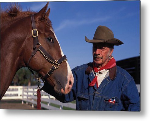 Brown Metal Print featuring the photograph The Marlboro Man In Ocala Florida by Carl Purcell