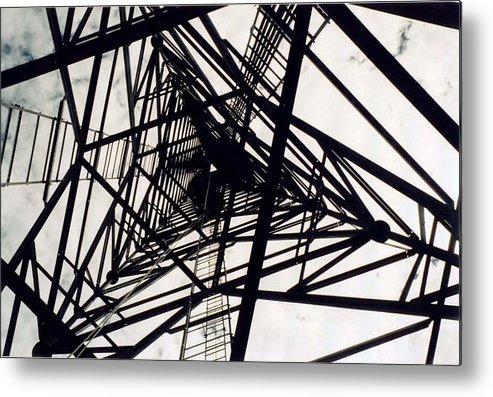 Rust Metal Print featuring the photograph Tower Grid by Margaret Fortunato